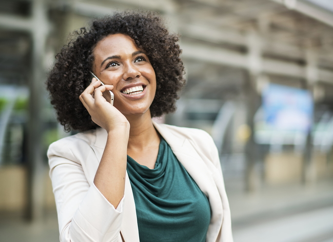 Here is a photo of a happy businesswoman talking on the phone regarding a tiling services in Echuca. Visit us at www.Echucatiling.com.au.