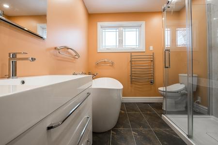 Bathroom renovation completed in Echuca with bronze finish floor tiles